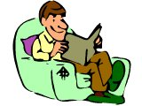 Man smiling as he reads in an armchair