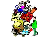A man with a shopping trolley loaded high with all this worldly goods `For Sale`