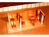 Model of Moses` Tabernacle in the Wilderness, with the coverings and a side removed.