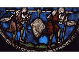 Two weary spies straining beneath a huge bunch of grapes - a stained glass window from Canterbury Cathedral, England