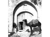 `Eye of a Needle` in the gate of a khan at Nazareth. The entrance to caravanserais in Palestine had a small door known as `the eye` for foot passengers. The huge doors are opened only for pack-animals or wheeled vehicles.