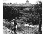 A man sows seed on the higher slopes of the Mount of Olives, not far from the village of Bethany. An early photograph.