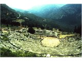 Delphi- Theatre (foreground), Temple of Apollo (centre). From her seat in the temple the oracle of Delphi gave out Apollo`s responses to questions brought by pilgrims. In the distance on the left is the school complex (gymnasium).