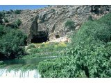 Caesarea Philippi, Baniyas - Temple of Pan with the River Baniyas, one of sources of Jordan.